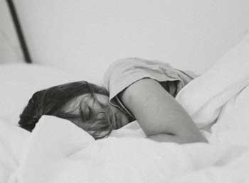 sleeping woman suffering form a sleep disorder
